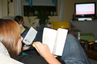 Students reading and watching TV. Now there's a novel idea.